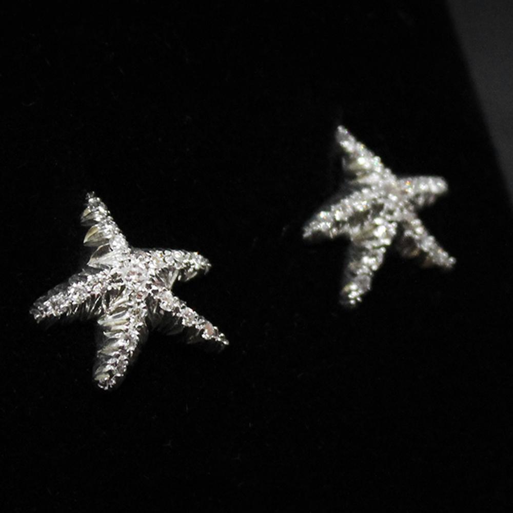 Orecchini stella marina con diamanti